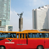 TransJakarta Bus In The Front Of The Roundabout