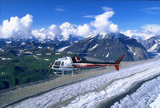 A Helicopter Tour Flies Over A Glacier