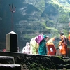 Priests & Devotees At The Cave Shrine