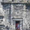 Visitors At Temple Door