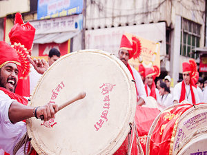 Dancing to the Dhols - Visarjan at Pune Photos
