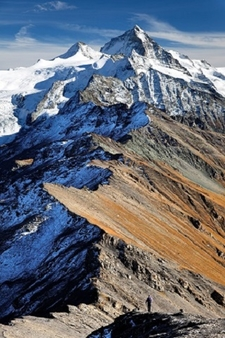 Hiker Below Dent Blanche In Swiss Alps