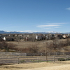 Houses In Westminster With The Rocky Mountains In The Backgroun