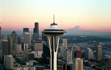 Space Needle With Skyline & Mount Rainier At Sunset
