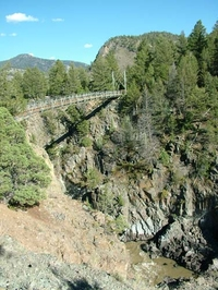 Suspension Bridge Crossing The Black Canyon