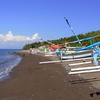 The Black Sand And Fishing Boats Of Amed Beach