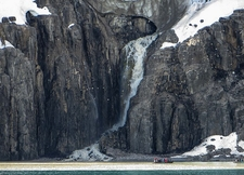 Waterfall From Melting Glacier In Svalbard