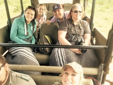 Guests Enjoying The Game Drive Aboard One Of Our Open Safari Vehicles.
